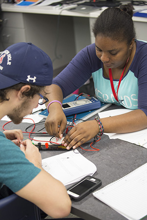 Students working on a circuit board