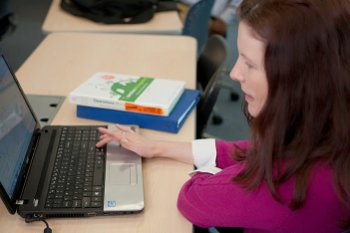 Adult Learner at her computer