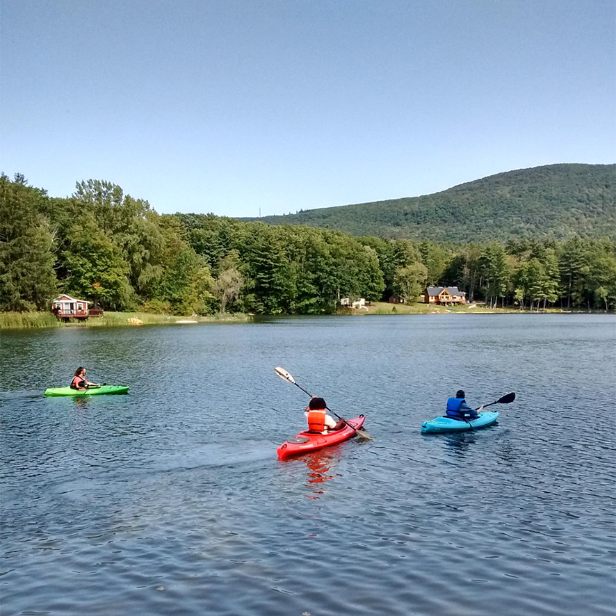 Environmental students kayak at a lake