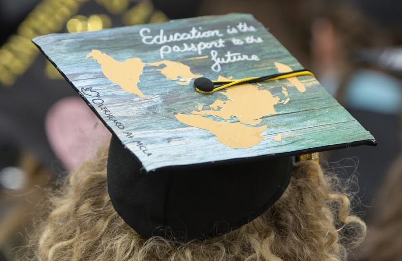 Grad's cap reading Education is the passport to the future